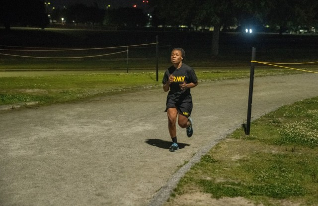 LT Agatha Kpamina, an officer with the Ghana Armed Forces, runs 5 miles on the track at Stewart-Watson Field, Fort Benning, Georgia.