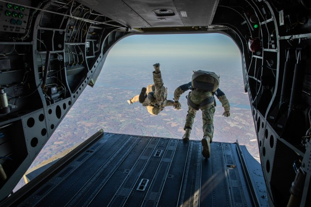 Maryland Army National Guard paratroopers begin to free-fall towards a drop zone from 12,000 feet above sea level during an airborne training operation at Aberdeen Proving Grounds, Maryland, Nov. 7, 2020.
