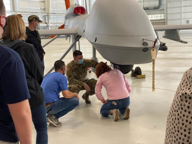 During the Fort Stewart-Hunter Army Airfield Combined Leadership Tour, community leaders visit with 3rd Combat Aviation Brigade Soldiers and get an