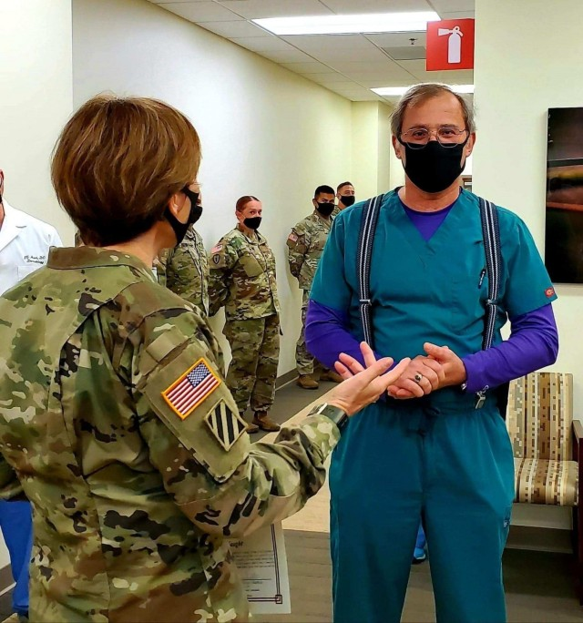 Martin Army Community Hospital's Family Medical Home Medical Director Dr. John Faught speaks with Regional Health Command Atlantic Commander Brig. Gen. Paula Lodi.