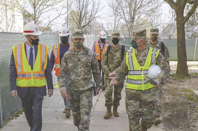 From left, Brian Smith, Garrison chief of housing; Sergeant Major of the Army Michael Grinston; and Garrison Command Sgt. Maj. Gregory Kleinholz, tour the renovations to enlisted barracks on Fort Belvoir, Tuesday.
