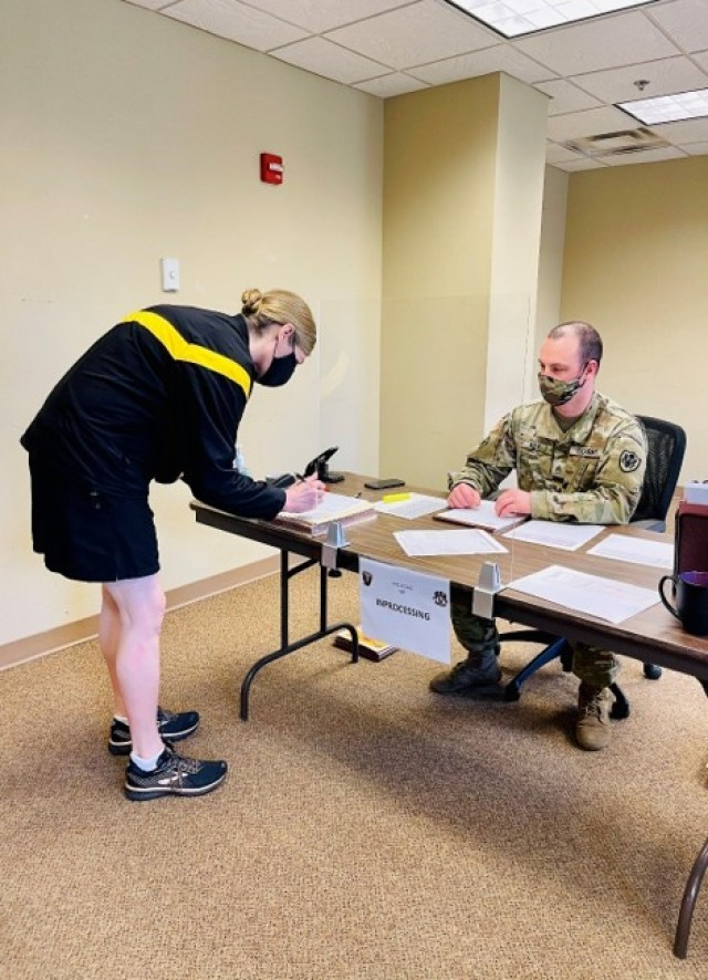 Joint Base Myer-Henderson Hall Commander Col. Kimberly Peeples reports to the first station in the Soldier readiness processing.