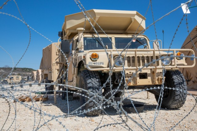 A III Corps Humvee sits behind a concertina wire barrier during Warfighter 21-4 March 29, 2021, at Fort Hood, Texas. U.S. III Corps, the French 3rd Division and the United Kingdom's 3rd Division worked together to conduct the exercise.