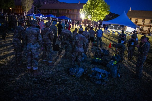 More than 250 Soldiers and civilians assembled on Brown Parade Field here beginning at 4 a.m. April 10, for the opening ceremony of the 2021 Bataan Memorial Death March sponsored by the 111th Military Intelligence Brigade and the Directorate of Family, Morale, Welfare and Recreation. The Bataan Memorial Death March is a challenging and grueling march that tests both mental and physical abilities. For the 2021 virtual experience, marchers can choose between the full 26.2-mile marathon length or a 14.2-mile honorary distance.