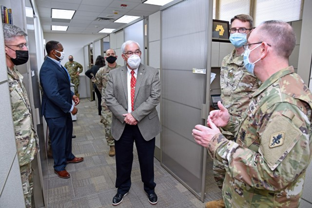 Col. James Jones, Interservice Physician Assistant Program Associate Professor (far right), briefs Mr. J.M. Harmon III, Deputy to the MEDCoE Commanding General, on the renovations and new furniture to their program area.