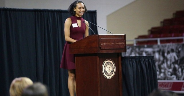 Larissa Heslop speaks at the 2018 Annual Eastern Kentucky University Championing Women's Athletics Luncheon at EKU in Richmond, Kentucky, in 2018. Heslop is now pursing her master's degree at the University of Kansas School of Public Affairs and Administration. Heslop's experience growing up as a military child helped shape her into who she is as a leader and her career goals.