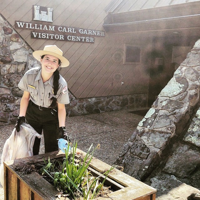Ranger Mary Simmons picks up trash for Earth Day at Greers Ferry Lake.