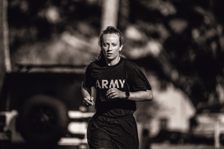1st Lt. Kelly Brown from Apache Troop, 3rd Squadron, 4th Cavalry Regiment, 3rd Infantry Brigade Combat Team, 25th Infantry Division conducts a 5-mile run as part of the Bronco Fitness Challenge at F-Quad, Schofield Barracks, Hawaii on Mar. 22, 2021. The Bronco Fitness Challenge is a competition over the course of three days that assesses Soldiers on their muscular strength, muscular endurance, anaerobic, and aerobic endurance in order to give feedback on their physical readiness and gain the title of the fittest Soldier in the brigade.
