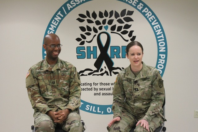 Attorneys Capts. Justin Hayes and Shannon Fields, special victims' counselors, respond to questions posed by Judy Oman, Fort Sill public affairs videographer. The video and others like it will soon appear on the Fires Center of Excellence Facebook page as part of the SHARP awareness month.