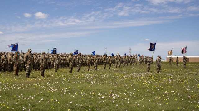 Task Force Phoenix units display their colors during a deployment ceremony after all mobilization training requirements were completed at North Fort Hood, Texas, April 18, 2021. During the ceremony, the colors of each unit within the Task Force were cased and put in a protective sheath in preparation for the Brigade's movement overseas.