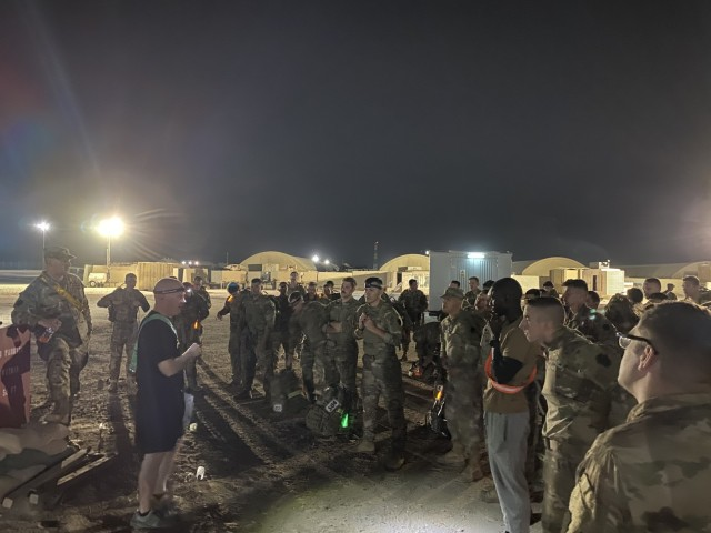 U.S. Soldiers with the 28th Expeditionary Combat Aviation Brigade, currently deployed to the Middle East, tested their minds and bodies during a grueling 18.6-mile ruck march, aiming to earn the Norwegian Foot March badge. The march required Soldiers to wear a 25-pound bag in full uniform and boots within a specified time.