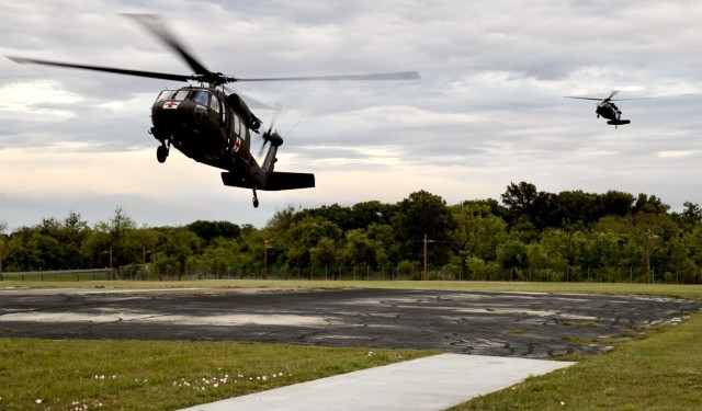 Task Force Phoenix UH-60 Black Hawk helicopters from G Company, 1st Battalion, 168th Aviation Regiment (General Support Aviation Battalion) land at North Fort Hood, Texas, April 17, 2021, during a MEDEVAC training mission that was part of a Culminating Training Exercise.