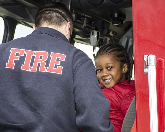 For a belated birthday treat, this youngster climbed into the front seat of a Dugway Proving Ground Fire Department engine when emergency units visited April 15, 2021. Police, fire, security and emergency medical vehicles came to wish him and his sister happy belated birthdays, Each received a swag bag and tours of the vehicles. Parents call DPG dispatch to schedule a visit. Photo by Al Vogel, Dugway Public Affairs