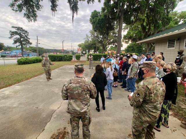 Fort Stewart-Hunter Army Airfield Garrison Commander, Col. Bryan Logan, greets attendees at the beginning of the installation's spring cemetery tour April 15 at the Liberty County Recreation Area in Hinesville.