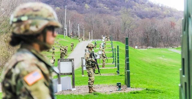 Competitors get ready to fire their M-4's during the M-4 range portion of the 52nd Sandhurst Military Skills competition on Saturday. Company G-4 was recognized with the Marksmanship Award during the awards ceremony.