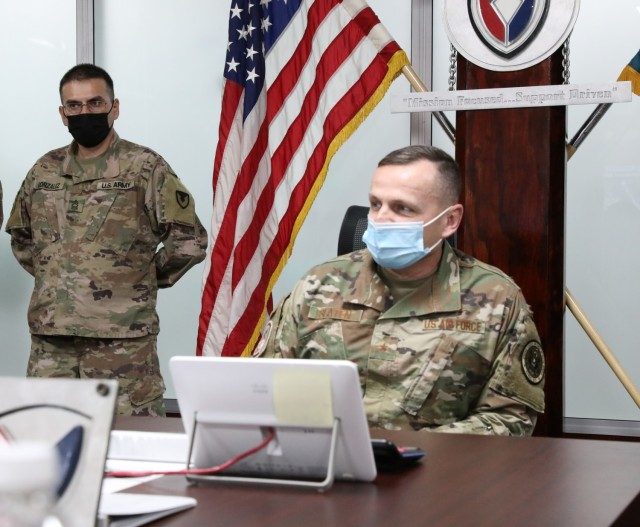 Air National Guard Brig. Gen. Darrin E. Slaten, the chief of office of military cooperation at the U.S. Embassy to Kuwait, receives a briefing concerning the Army Preposition Stock Program from Lt. Col. Nichole Vild, commander of the 401st Army Field Support Battalion-Kuwait at Camp Arifjan, Kuwait. (U.S. Army photo by Capt. Elizabeth Rogers)