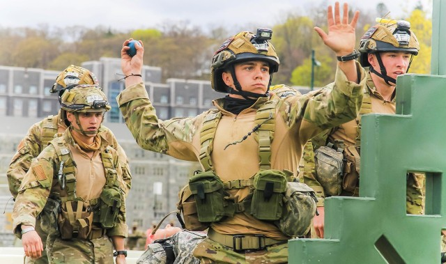 A member from the U.S. Air Force Academy team (above) throws a grenade while the group runs through the Crucible Challenge at the 52nd Sandhurst Military Skills Competition April 17. USAFA performed with great intensity as it ranked third in the Sandhurst relay leaving USMA Black in fourth place and the U.S. Naval academy team in fifth place at that juncture. USAFA finished eighth overall at Sandhurst.