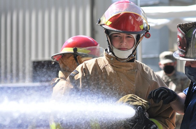 Pvt. Benjamin Szulgit -- an 88k Watercraft Operator Course student -- grips the hose tightly during the hose-handling exercise portion of firefighting training April 16 at the Transportation School's fire trainer.