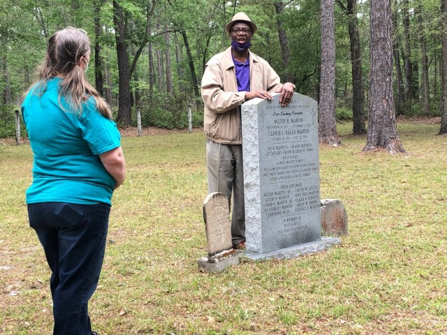Chairman of the Liberty County Board of Commissioners and local historian, Donald Lovette shares a story with tour participants, April 15 at Cypress Creek Cemetery on Fort Stewart.