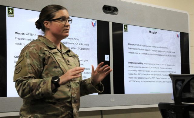 Lt. Col. Nichole Vild, commander of the 401st Army Field Support Battalion-Kuwait gives a briefing about the mission and core responsibility of the 401st AFSB and the Army's Prepositioned Stock program to the senior military advisor to the U.S. Ambassador to Kuwait and Soldiers from the 1st Theater Sustainment Command, Operational Command Post at Camp Arifjan, Kuwait on April 2, 2021. (U.S. Army photo by Capt. Elizabeth Rogers)