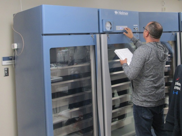 Felix Ortiz-Plaza, Fort Leonard Wood Blood Donor Center quality assurance officer, validates temperatures on a scientific refrigerator used to store blood in the newly constructed blood donor center.