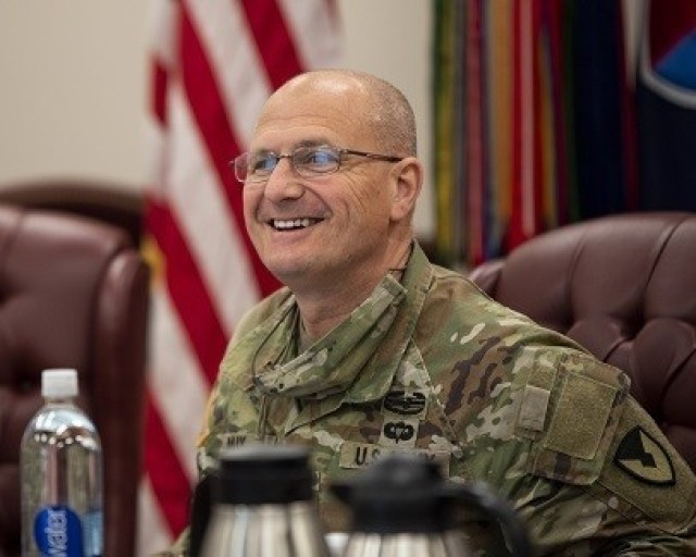 Gen. Ed Daly, commanding general of the U.S. Army Materiel Command, enjoys a lighter moment during an update briefing given April 22 at the U.S. Army Sustainment Command headquarters at Rock Island Arsenal, Illinois. (Photo by Linda Lambiotte, ASC Public Affairs)