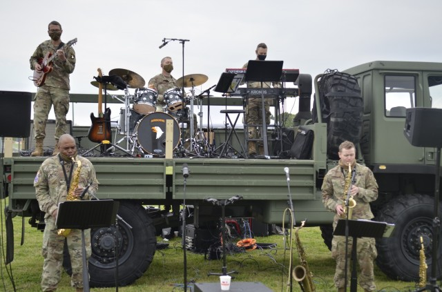 Members of the 101st Airborne Division (Air Assault) Band provide live music April 17 during Kidsfest: Magical Drive-thru, hosted by Morale, Welfare and Recreation at the division parade field.