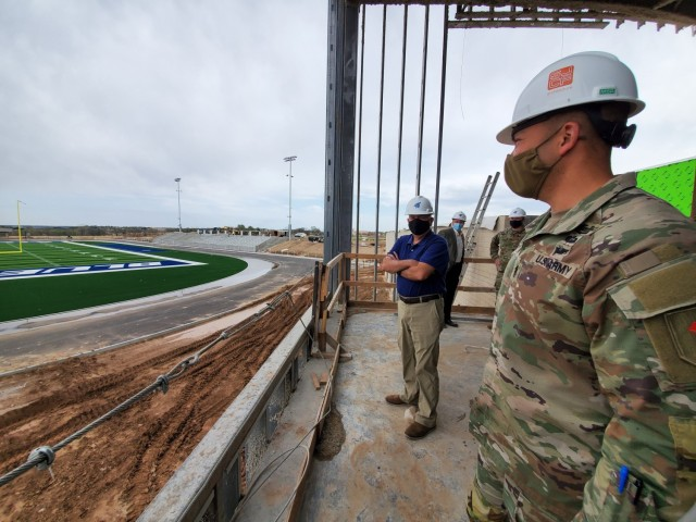 Command Sgt. Maj. Raymond Harris, the 1st Infantry Division senior enlisted leader toured the Junction City High School construction project April 9, 2021.  D. Scott Stuckey, a civilian liaison to teh Chief of Staff of the Army also accompanied the tour and learned about the engineering behind the construction. For example, several cement walls were cast on-site and hoisted into place with a crane, saving the district on transportation and the cost of off-site labor.