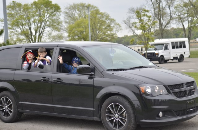 Costumed children take in the sights and sounds of Kidsfest: Magical Drive-thru, hosted April 17 at the division parade field.