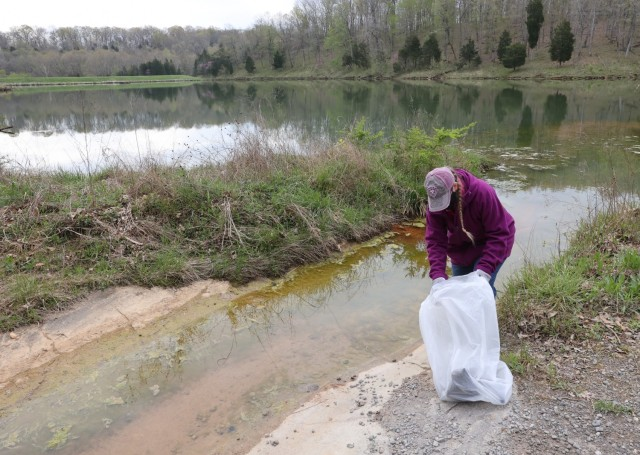 Members of the U.S. Army Recruiting Command, together with Family members and volunteers hiked through outdoor areas at and around Fort Knox April 23 to honor Earth Day and remove any trash.