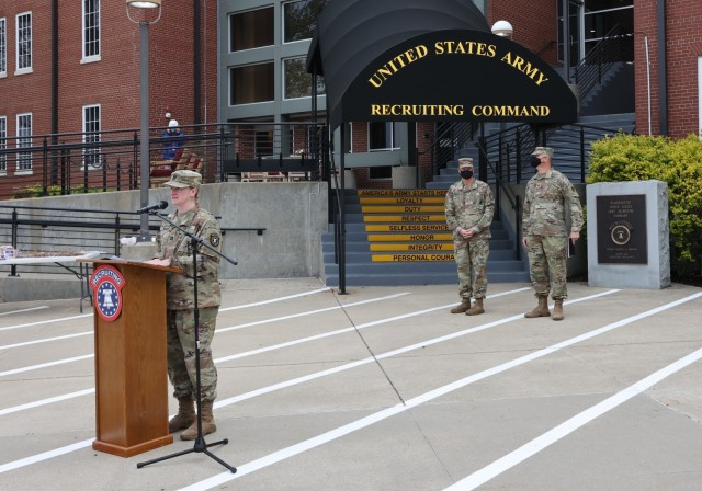USAREC Headquarters Company Commander Capt. Jewel Burgherr addresses Soldiers and volunteers prior to the 2021 day of action cleanup.