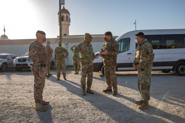 Gen. Michael Garrett, U.S. Army Forces Command commanding general, visits the U.K.'s primary site during Warfighter Exercise 21-4 April 8 at Fort Hood, Texas. Warfighter 21-4 trained allied participants to increase interoperability on the battlefield and strengthen bonds among NATO allies. (U.S. Army Photo by Sgt. Evan Ruchotzke).