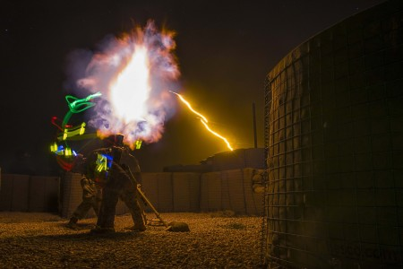 Soldiers fire illumination rounds from a 120 mm mortar during live-fire training in Syria, March 16, 2021.
