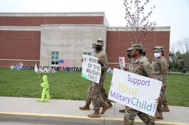 Soldiers from the 1st Theater Sustainment Command depart Kingsolver Elementary School at Fort Knox, Kentucky, April 23, 2021 after cheering on and providing encouragement to the children arriving for class .The month of April is designated as Month of the Military Child to let children know that their resiliency and ability to change and adapt is appreciated.   during the Month of the Military Child. (U.S. Army photo by Staff Sgt. Nahjier Williams, 1st TSC PAO)