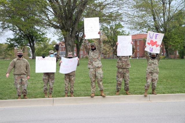 Soldiers with the 1st Theater Sustainment Command showed their support for the children attending Kingsolver Elementary School at Fort Knox, Kentucky, April 23, 2021. The Soldiers created posters and cheered on the families of the Fort Knox community in observance of the Month of the Military Child. (U.S. Army photo by Staff Sgt. Nahjier Williams, 1st TSC PAO)