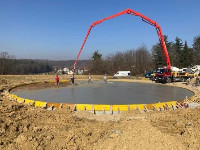 Crews pour concrete at the site for a new helicopter landing zone at the primary hospital in Karlovac, Croatia in March 2021 as part of a project being managed by the U.S. Army Corps of Engineers, Europe District in support of the U.S. European Command and in close coordination with the U.S. Embassy in Croatia. The site is one of three helicopter landing zones being built to improve local emergency medical response capabilities and help save lives. (Courtesy Photo)