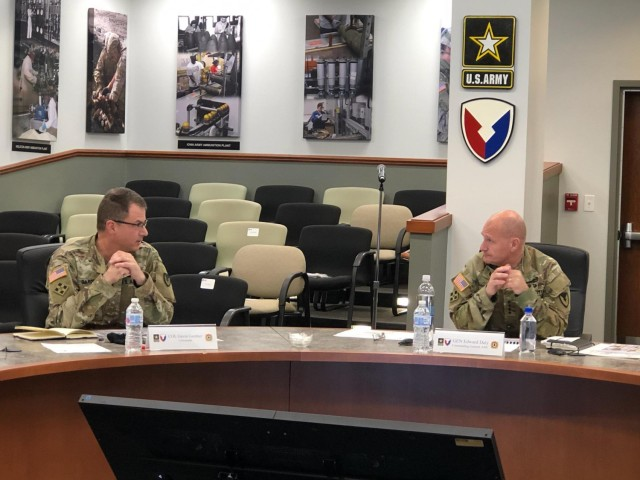 JMC Commander, Col. Gavin Gardner (left) discusses the welfare of JMC employees and modernizing the JMC Organic Industrial Base with AMC Commander, Gen. Daly (right).