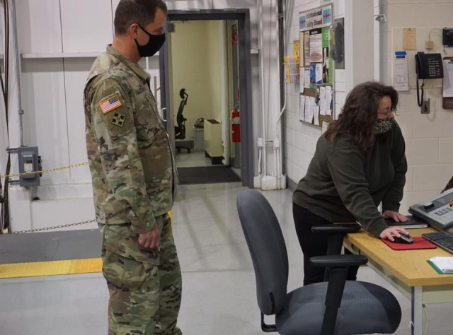 Maintenance and Demil Quality Division Chief, Lisa Michael, demonstrates Letterkenny Munitions Center's current testing capability to Col. Gardner, JMC commander.  LEMC is a JMC subordinate installation.