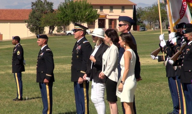 Chief Warrant Officer Five John Segerlund and family stand on  Brown Parade Field  as the Soldier retires after 35 years of military service at a ceremony on Fort Huachuca, Ariz.