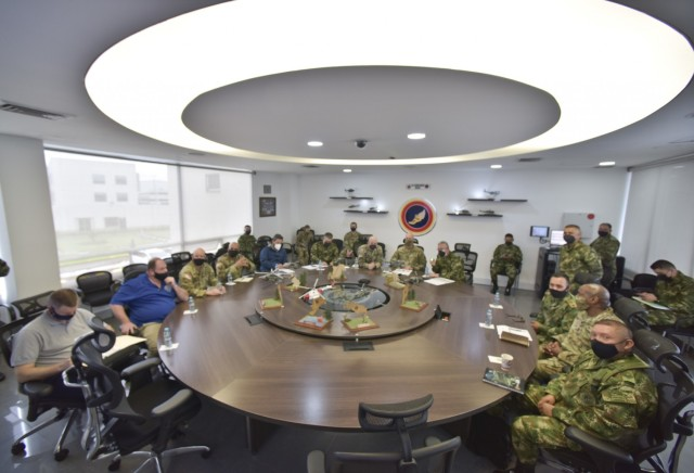 Maj. Gen.Elder Giraldo, chief of operations for the Columbian Army, center, briefs Brig. Gen. Douglas Lowrey, commander of U.S. Army Security Assistance Command, during a key leader engagement at the División de Aviación Asalto Aéreo headquarters in Bogota, Colombia, 6 April 2021. Lt. Col. Andrew Pesature, left, Army Chief of Missions at U.S. Embassy, provides translation services. Brig. Gen. Lowrey, and members of his staff, visited several sites to see the impact of U.S. security assistance and foreign military sales, in support of the Colombian military in defending their country from counter-narcotic and terrorist threats. (U.S. Army photo by Richard Bumgardner)