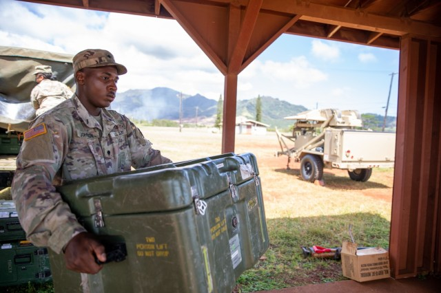 Spc. Nazir Johnson, an Information Technology Specialist with the 73rd Signal Company, Division Sustainment Troops Battalion, 25th Infantry Division Sustainment Brigade, 25th Infantry Division, moves phone equipment during a training exercise on Schofield Barracks, Hawaii on April 22, 2021. This exercise validates signal soldiers on the brigade's Joint Node Network after 3 years of inoperation. (U.S. Army photo by Spc. Michael Bradle)