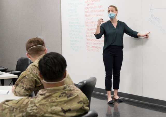 Megan Helf (MRT-PE) facilitates discussion during SLDC.