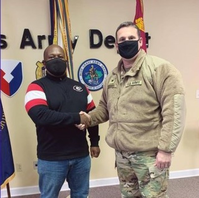 Blue Grass Army Depot Commander, Col. Steve Dorris, shows his gratitude for Production Controller Manassah Williams' dedication to the Joint Warfighter. BGAD is a JMC subordinate installation.