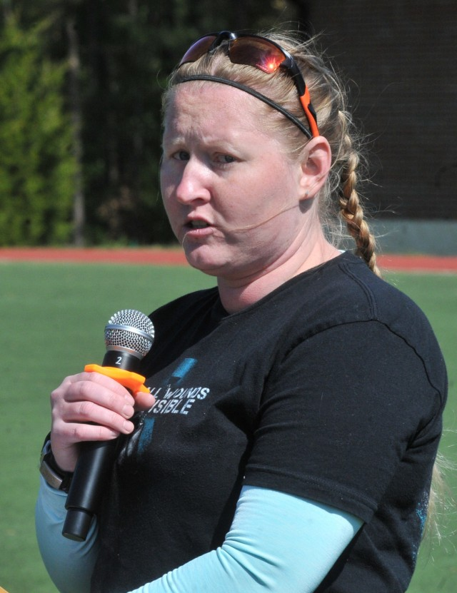 Former Staff Sgt. Elena Rooney speaks before students at the annual Jumping for SHARP event April 22 at Stillions Field.