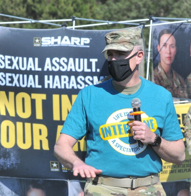 """Col. Jason P. Affolder, 23rd Quartermaster Brigade commander, speaks to a crowd of Soldiers at the annual Jumping for SHARP event, held April 22 on Fort Lee's Stillions Field.  Noting how sexual assault and harassment has a way of eroding trust in relationships and organizations, Affolder said there are """"things we need to be talking about if we're ever going to make our Army and our country better."""" Also on-hand to speak to a crowd of cadre and roughly 50 advanced individual training troops were former Staff Sgt. Elena Rooney, Chief Warrant Officer 2 Virginia Greer and Sgt. 1st Class Denisse Liggens, all sexual assault survivors. Each shared their experiences and recommended ways to be supportive of battle buddies. The event was moved from Fort Pickett due to air crew non-availability. (U.S. Army photo by T. Anthony Bell)"""