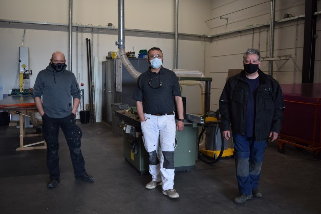 BRUNSSUM, Netherlands -- From left, Jeroen Smeets, carpenter; Hilmo Korac, painter; and Math Kubben, ground maintenance worke, at U.S. Army Garrison Benelux - Brunssum collectively share 72 years of experience working for the U.S. Army in the Netherlands and the tri-border area. (U.S. Army photo by Naomi van Loon, USAG Benelux Public Affairs)