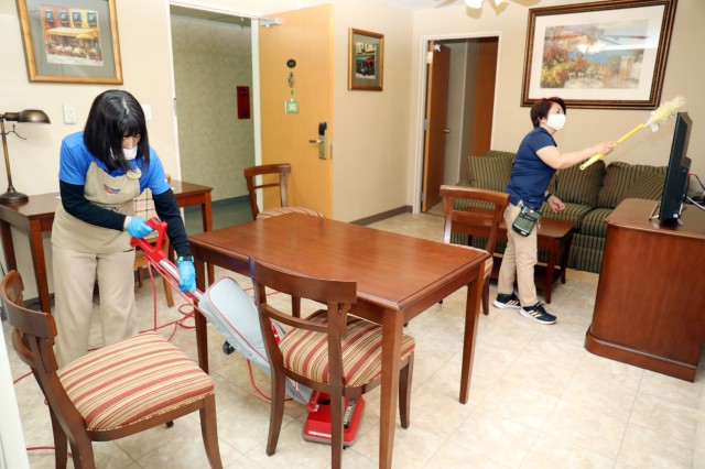 Hanako Shigemori, left, housekeeper, and Maria Devera, housekeeping leader, prepare a room for new guests at Camp Zama Army Lodging, Camp Zama, Japan, April 28.