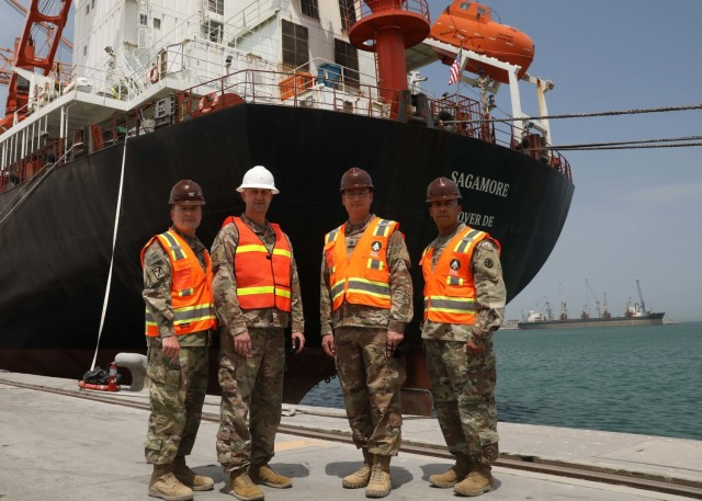 1st Theater Sustainment Command leaders, Col. Michael Ludwick, commander of the 595th Transportation Brigade (SDDC); Brig. Gen. Justin M. Swanson, deputy commanding general, 1st TSC; Command Sgt. Maj. Keith Gwin, 1st TSC; and Command Sgt. Luis Benitez; 595th TB (SDDC), stand at the pier in front the container ship Sagamore during the April  24, 2021 ammo off-load-on-load operations at Kuwait's Port Shuaiba. Sagamore delivered critical munitions to the U.S. Central Command area of operations, as well as taking on munitions for refurbishment. (U.S. Army photo by Staff Sgt. Neil W. McCabe)