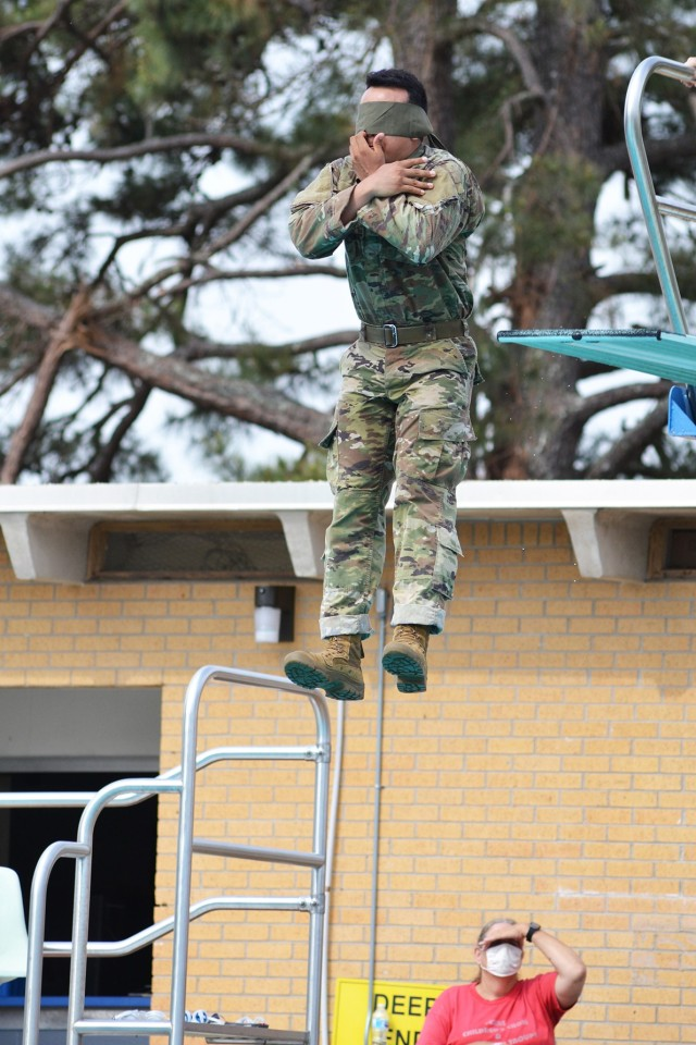 Sgt. Jesus Gil takes a blindfolded plunge from the high dive during Army Combat Water Survival test portion of the Bayne-Jones Army Community Hospital Soldier and Noncommissioned Officer of the Year competition April 15 at the Joint Readiness Training Center and Fort Polk.