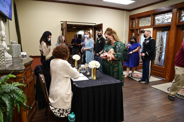 Guests attending the Volunteer of the Year celebration enter the Warrior Center  April 13.